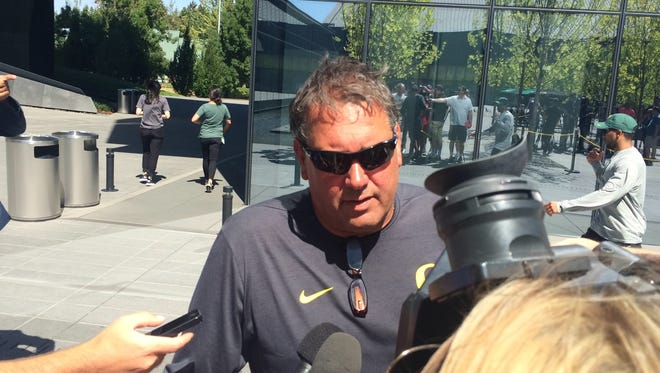 Oregon defensive coordinator Brady Hoke talks to the media after Thursday's scrimmage.