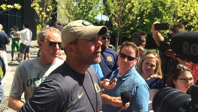 Oregon head coach Mark Helfrich talks to the media after Thursday's scrimmage.
