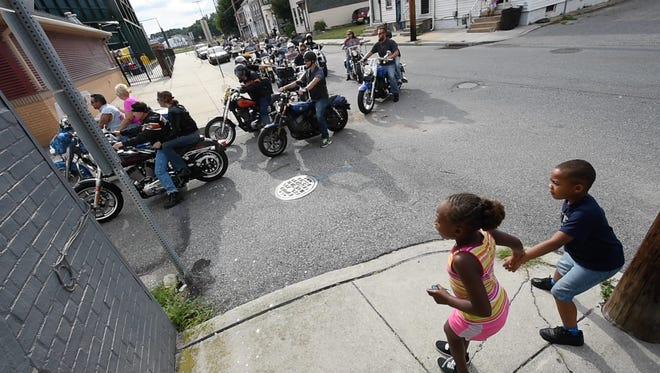 Children watch 35 Harley riders turn into PeoplesBank Park from Arch Street as the bikes stage to make a trip around home plate Saturday Sept. 3, 2016. The event is a fundraiser for the Keystone Wounded Warriors.