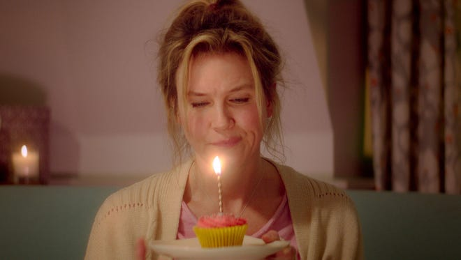"Renee Zellweger celebrates, sort of, in ""Bridget Jones's Baby,"" which hits theaters on Friday."