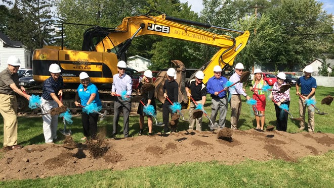 Greater Green Bay Habitat for Humanity officials joined city leaders and dignitaries to break ground on a new housing project at East Walnut and Baird streets Monday.