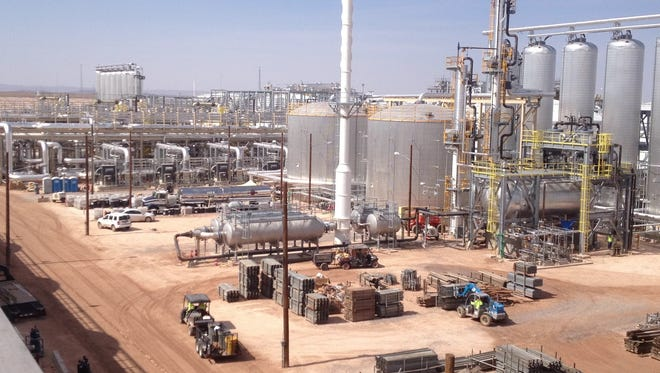 Large tanks of molten salt and other equipment at Solana Generating Station sit amid a 3-square-mile field of mirrors.