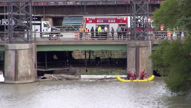 Rescue crews work to recover a body that was found Monday, Sept. 26, in the Genesee River.