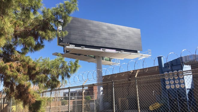 Phoenix police said they were investigating after a billboard that had featured a Donald Trump campaign sign was defaced. The sign was covered up by midmorning Oct. 3, 2016.