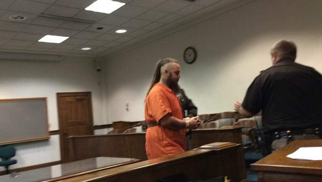 Schrap is led from the courtroom after his appearance Thursday.