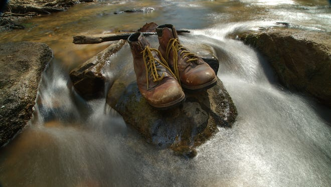 Hikers take these boots on a journey