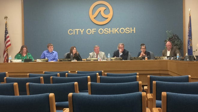 The Oshkosh Common Council discusses the issue of paid on-street parking downtown during its Oct. 11, 2016, meeting.