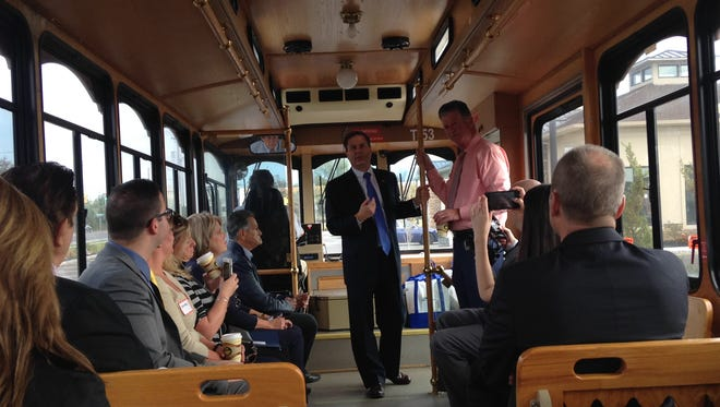 Rep. Donald Norcross (center) talks with those interested in economic development opportunities in Williamstown Thursday during a trolley ride through town with Mayor Dan Teefy (right).