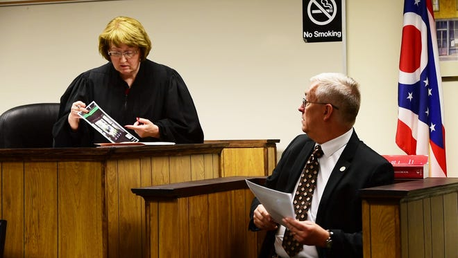 Visiting Judge Patricia Cosgrove, here questioning Gibsonburg police Chief Paul Whitaker at Sheriff Kyle Overmyer's bond-revocation hearing Nov. 3, has issued a gag order in the Overmyer case.