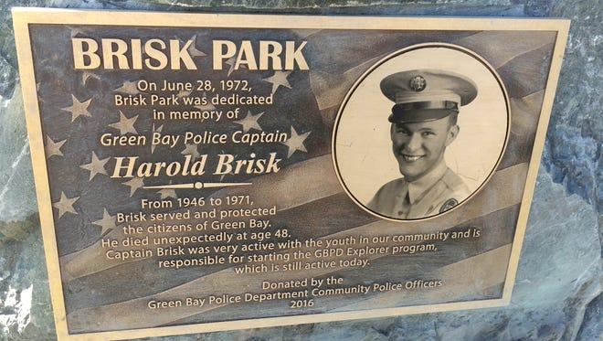 A new plaque honoring Capt. Harold Brisk stands in Brisk Park in Green Bay.