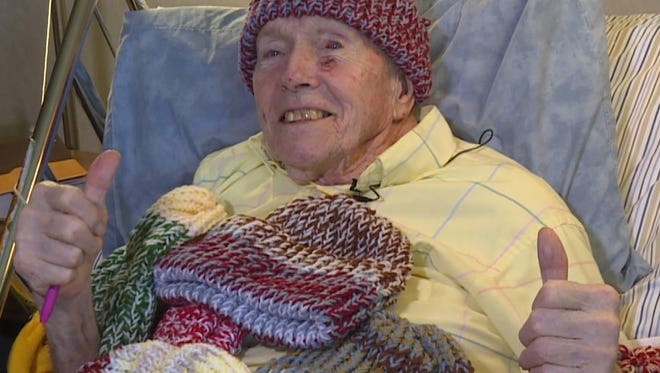 Morrie, 91, knits hats for the homeless.