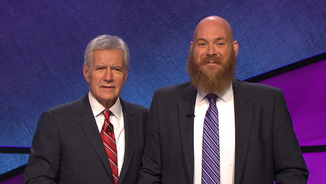 """Henderson resident Jay Johnson (right) poses with """"Jeopardy!"""" game show host Alex Trebek."""