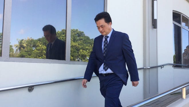Kwon Woo Sung leaves District Court of Guam on Nov. 28. Kwon is asking the judge to allow him to return to Korea without spending additional time in jail for his unruly behavior on a Korean Air flight.