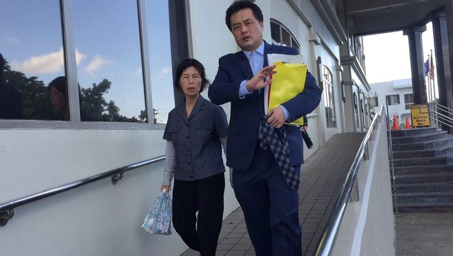 In this Nov. 29, 2016, file photo Yang Young Hwa, left, mother of Kwon Woo Sung, right, leaves the District Court of Guam in Hagåtña. Kwon was sentenced to three years for interfering with the flight crew on a Korean Air flight bound for Guam. He won his appeal to U.S. 9th Circuit Court of Appeals.
