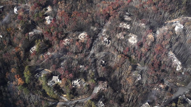 An aerial view shows destroyed homes the day after a wildfire that hit Gatlinburg on Tuesday, Nov. 29, 2016, in Sevier County.