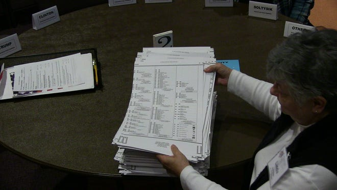 Recount team member Linda Smith stacks Calhoun County ballots Wednesday.
