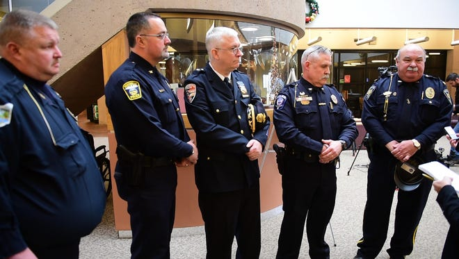 From left, Green Springs Police Chief Charles Horne III, Woodville Police Chief Roy Whitehead, Gibsonburg Police Chief Paul Whitaker, Bellevue Police Chief Mark Kaufman and Clyde Police Chief Bruce Gower said former Sandusky County Sheriff Kyle Overmyer's words and actions took a toll on area law-enforcement.
