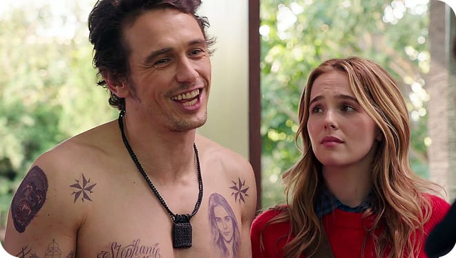 """A Silicon Valley entrepreneur billionaire (James Franco, left) doesn't quite win the approval of the parents of his girlfriend (Zoey Deutch, right) in """"Why Him?"""" new in theaters."""
