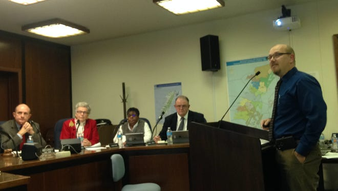 Accomack County Finance Director Michael Mason gives a presentation about a proposed employee raise to the Accomack County Board of Superisors on Wednesday, Dec. 21, 2016. Mason later in the meeting was named acting county administrator effective Feb. 1, 2017, after the board accepted Steve Miner's resignation.
