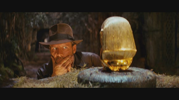 """Archaeologist Indiana Jones tries to figure out how to pilfer a golden idol in """"Raiders of the Lost Ark."""""""