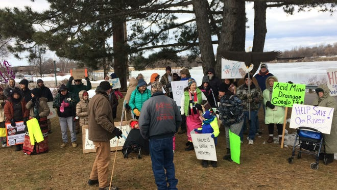 Protesters gather on the Wisconsin side of the Menominee River.
