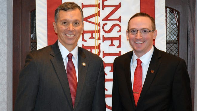 Mansfield University President Fran Hendricks, left, introduced Ryan Ehrie as director of athletics Tuesday.