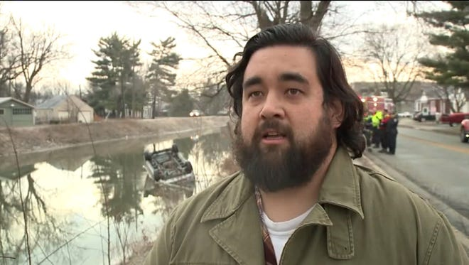 Fox59 photojournalist Greg Dunn pulled a woman out of the car behind him after it landed in the Broad Ripple canal on Wednesday