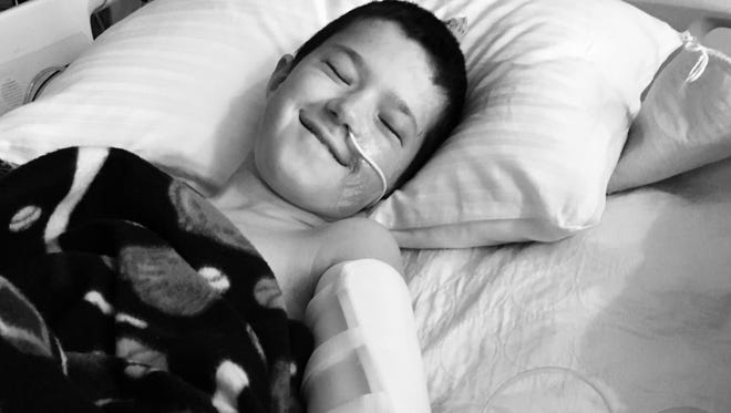 Garrett Rogers smiling at the hospital after the accident.