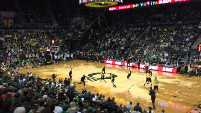 Oregon football coaches and players scrimmage against each other in basketball Saturday during halftime of the Civil War basketball game.