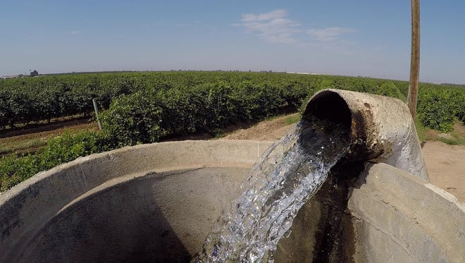 Water flows from a well into a standpipe on a farm in Tulare County.