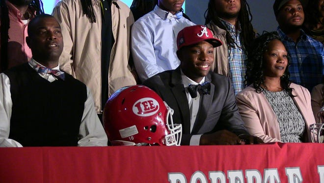 Flanked by his parents Henry Jr. and Nataki Ruggs, Henry Ruggs III is surrounded by family and friends as he signed Wednesday with the University of Alabama on National Signing Day.