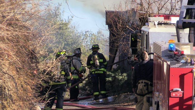 Armonk firefighters along with neighboring departments work at the scene of a barn fire at 23 Wampus Lakes Drive in Armonk, Feb. 4, 2017.