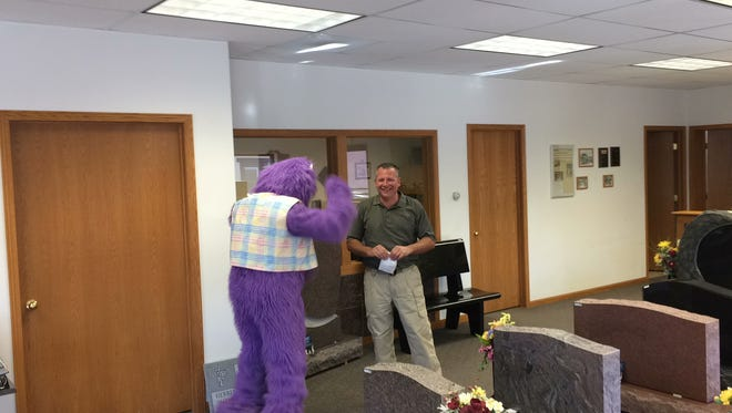 The gorilla from Fun Factory Sweet Shoppe in Rhinelander visits Marshfield Monument and Brian Hopperdietzel on Thursday in downtown Marshfield. Fun Factory Sweet Shoppe is opening a temporary location through Valentine's Day at 405 S. Central Ave.