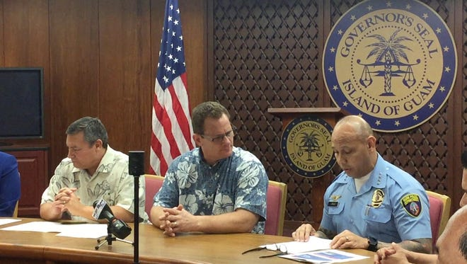 Gov. Eddie Calvo, Lt. Gov. Ray Tenorio and Guam Police Department Chief Joseph I. Cruz during the signing of an executive order on Feb. 10, 2017, to create the Mandaña Drug Task Force.