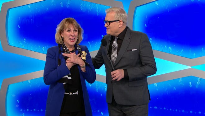 Marlton's Linda Baquero (left) is shown with 'The Price Is Right' host Drew Carey on a show that was taped in November and aired Friday. Baquero won the showcase and more than $78,000 in total prizes. She also won a bonus, which was a trip to the Grammy Awards.