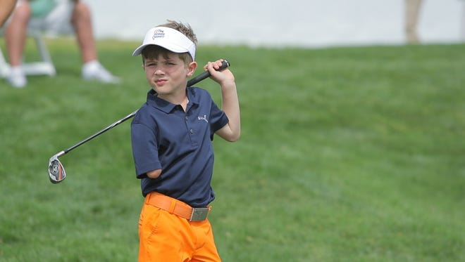 Tommy Morrissey, 6, took on the best players in the world from 60 yards short of the 18th green at PGA National Resort & Spa on Feb. 21.