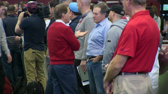 Alabama coach Nick Saban (in red sweater) and New England Patriots coach Bill Belichick talk during Alabama's Pro Day Wednesday in Tuscaloosa.