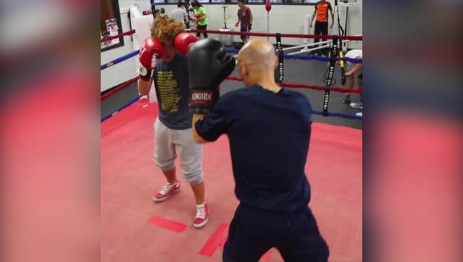 """Des Moines Senior Police Officer John Saunders manages the Des Moines Police Boxing Club. He's one of many featured in the USA Today special series, """"I am an American."""""""