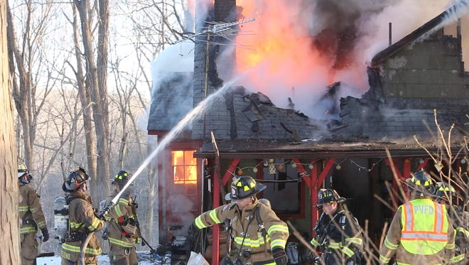 Putnam Valley firefighters battle a house fire on Woods End Road in Putnam Valley March 23, 2017. Firefighters from Mahopac Falls, Garrison, Kent and Mohegan Lake firefighters assisted at the scene. The elderly homeowner was transported to the hospital by Putnam Valley Fire ambulance.