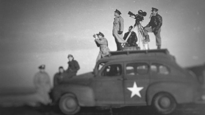 """John Ford leads a camera crew shooting footage during World War II, from the new documentary series """"Five Came Back."""""""