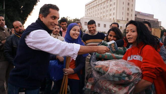 """In the midst of the Egyptian Arab Spring, Bassem Youssef makes a decision that's every mother's worst nightmare: He leaves his job as a heart surgeon to become a full-time comedian. He is soon dubbed """"the Egyptian Jon Stewart"""" after he creates and hosts a weekly satirical news show that becomes the most viewed TV program in the Middle East, with 30 million viewers per episode. In a country where free speech is not settled law, Bassem's show becomes as controversial as it popular. He and his staff must endure physical threats, protests and legal action, all because of jokes. Despite increasing danger, the team at """"Al Bernameg"""" employ comedy, not violence, to comment on hypocrisy in media, politics, and religion. """"Tickling Giants"""" follows the team as the show earns a supportive fan in Stewart and they discover democracy is not easily won. The young women and men working on Bassem's show are fearless revolutionaries, who just happen to be really, really funny."""