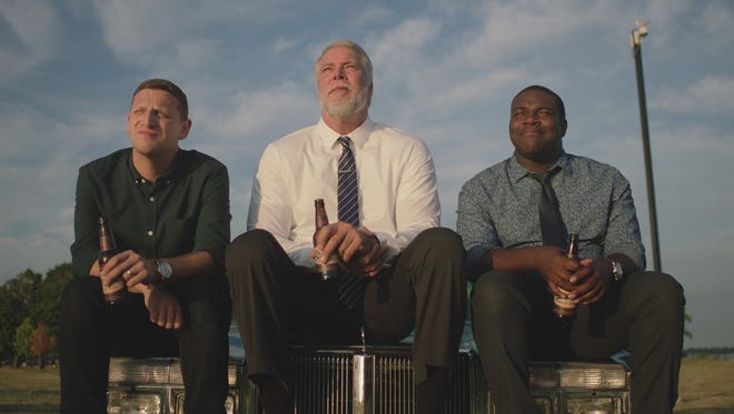 Tim Robinson, Kevin Nash, and Sam Richardson in a scene from Comedy Central's 'Detroiters.'