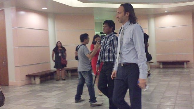 Mario Laxamana, in plaid shirt, leaves the Superior Court of Guam after his sentencing hearing on April 7, 2017.