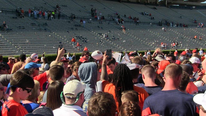 Auburn quarterback Jarrett Stidham signs autographs after Saturday's A-Day game at Jordan-Hare Stadium.