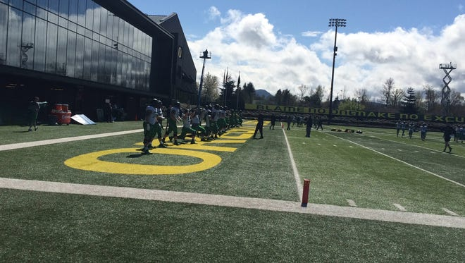 Oregon football players compete in drills Saturday during practice.