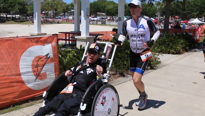 Johnny Agar and his dad Jeff run in an Ironman competition in Florida.