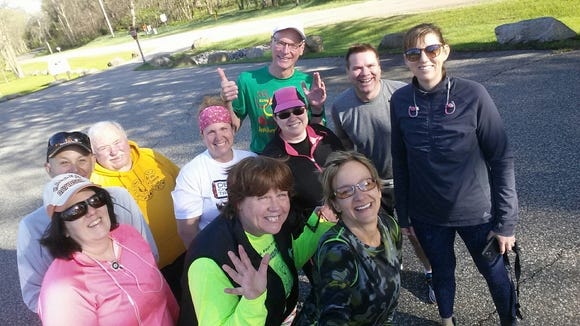 The Adams County Running Club starts each workout with a photo. I'm in the back in the gray. I don't like my photo taken, but that is a genuine smile.