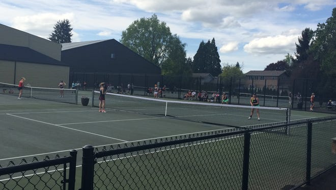 First day action at the GVC district tennis meet at Salem Tennis and Swim Club.