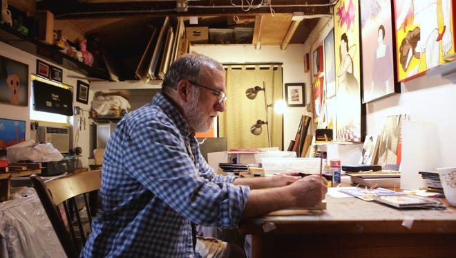 Bill Humphries at work on a painting.