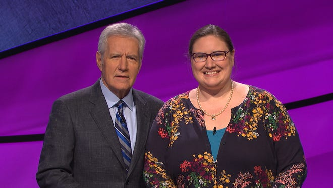 "Chantelle Schofield (right) with ""Jeopardy"" host Alex Trebek. Schofield competed on the TV quiz show Monday night."